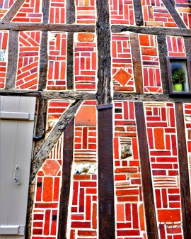 The half-timbered walls filled in a very decorative way. Beauvais, France.
