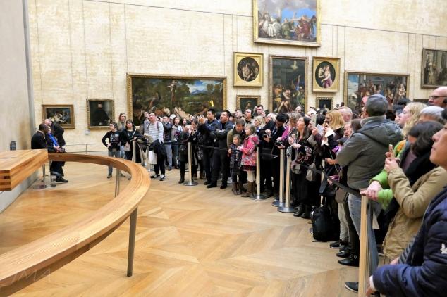 Mona Lisa, Louvre, Paris, crowds in the paintings gallery.