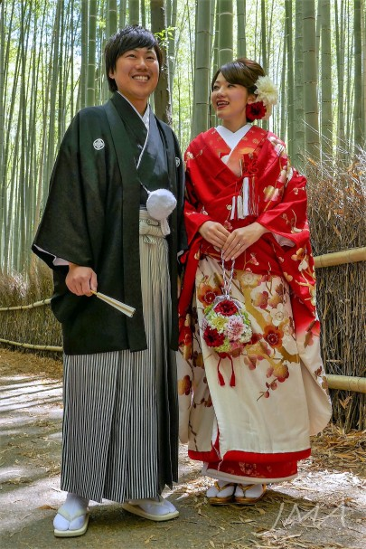A newly married Japanese couple. Seen in Arashiyama bamboo forest, Japan