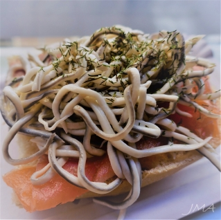 Spanish food. Gulas, a delicious Spanish appetizer / tapas made of fish at Mercado de San Miguel in Madrid, Spain.