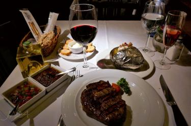 Spanish food. Delicious Spanish stake and a sip of red wine.