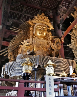 One of two smaller Buddha statues in the Great Buddha Hall in the Tōdai-ji temple complex in Nara, Japan