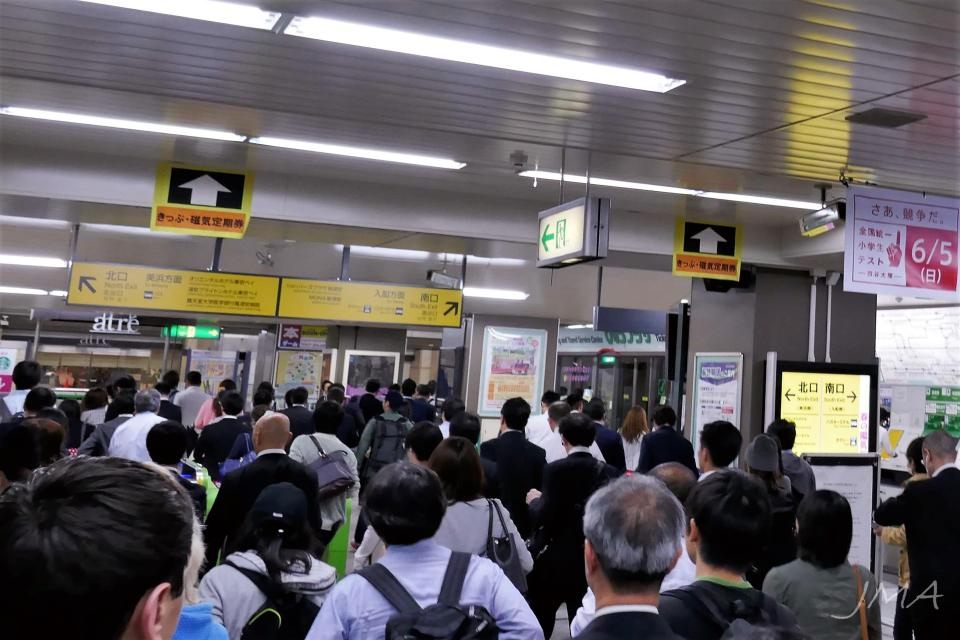 Japanese public transport. A local commuter station in greater Tokyo area half past midnight. Crowded.