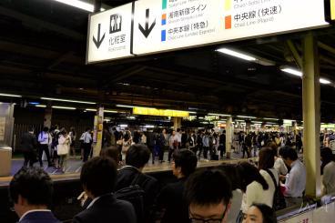 Japanese public transport. Shinjuku railway station at midnight. Crowded