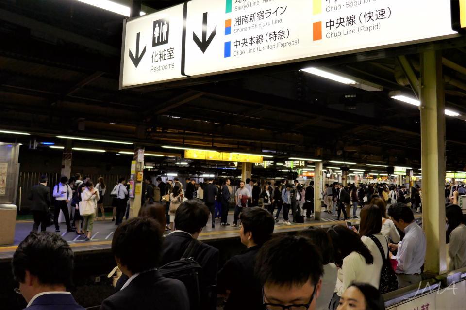 Japanese public transport. Shinjuku railway station at midnight. Crowded.
