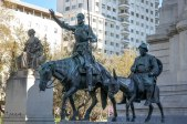 Don Quixote and Sancho Panza at the foot of the monument to Miguel de Cervantes Saavedra at Plaza de España
