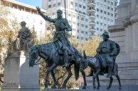 Don Quixote and Sancho Panza at the foot of the monument to Miguel de Cervantes Saavedra at Plaza de España
